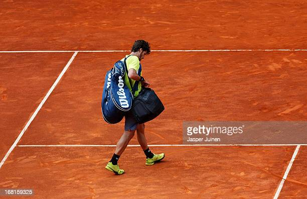 Felicano Lopez of Spain trudges off centre court after loosing his match against his fellow countryman Daniel GimenoTraver during day three of the...