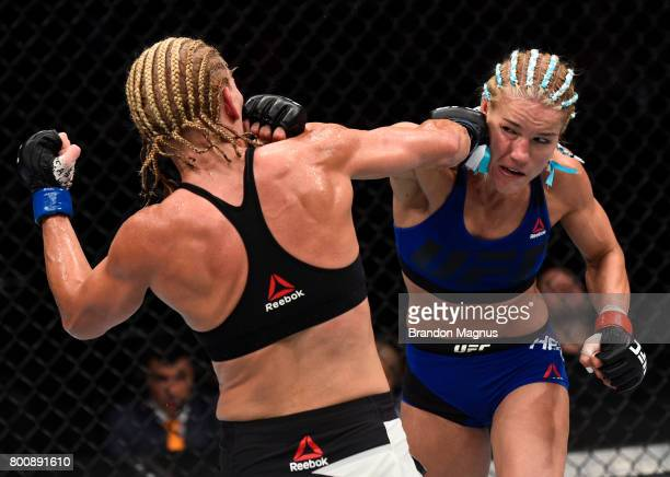 Felice Herrig and Justine Kish trade punches in their women's strawweight bout during the UFC Fight Night event at the Chesapeake Energy Arena on...