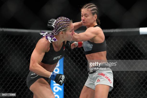 Felice Herrig and Karolina Kowalkiewicz trade punches during their strawweight bout at UFC 223 at Barclays Center on April 7 2018 in New York City