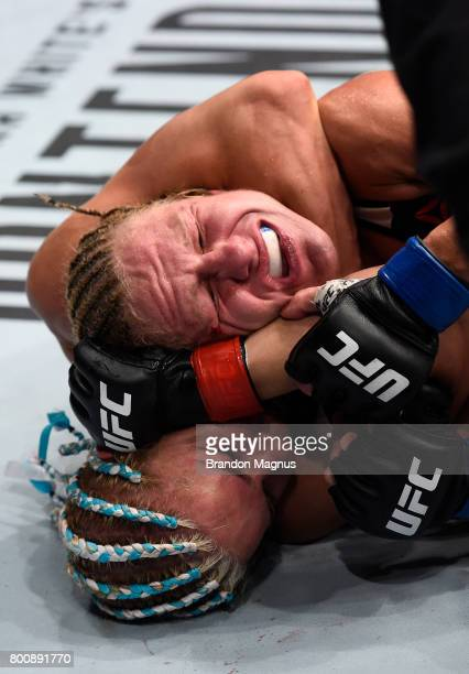 Felice Herrig attempts to secure a rear choke submission against Justine Kish in their women's strawweight bout during the UFC Fight Night event at...