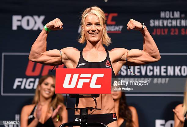 Felice Herrig poses on the scale during the UFC weighin at the United Center on July 22 2016 in Chicago Illinois