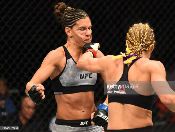 Felice Herrig punches Cortney Casey in their women's strawweight bout during the UFC 218 event inside Little Caesars Arena on December 02 2017 in...