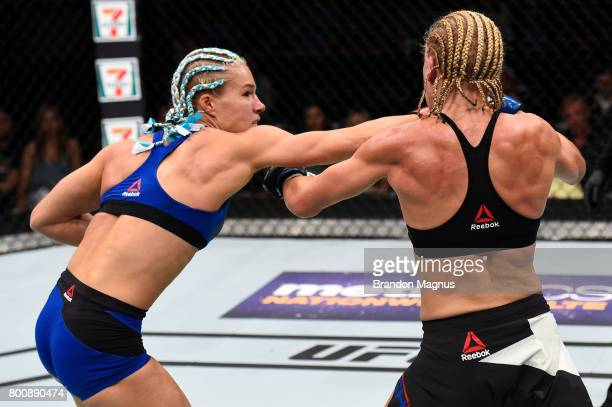Felice Herrig punches Justine Kish in their women's strawweight bout during the UFC Fight Night event at the Chesapeake Energy Arena on June 25 2017...