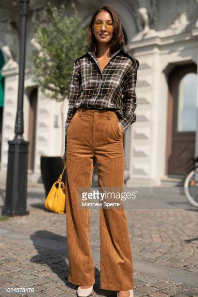 Felicia Akerstrom Ma is seen on the street during Fashion Week Stockholm wearing plaid shirt with tan corduroy pants on August 28 2018 in Stockholm...