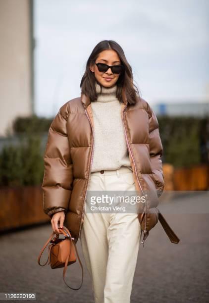 Felicia Akerstrom Ma is seen wearing brown puffer jacket, mini Loewe bag, grey turtleneck, cropped pants outside Nanushka lunch during the Copenhagen...