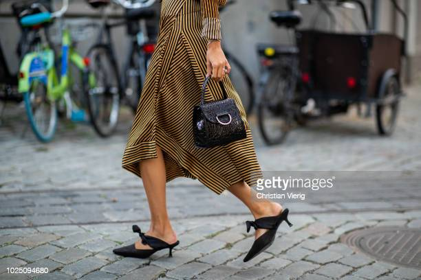 Felicia Akerstrom Ma wearing gold brown striped dress seen during Stockholm Runway SS19 on August 29 2018 in Stockholm Sweden