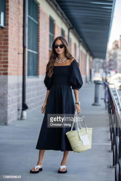 Felicia Akerstrom wearing Loewe basket bag is seen during Stockholm Fashion Week Digital Edition 2020 on August 25, 2020 in Stockholm, Sweden.