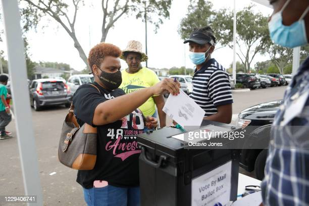 Felicia Bottom cast her mail-in voting ballot at the C. Blythe Andrews, Jr. Public Library during the NAACP Hillsborough County Branch Souls to the...