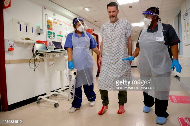 Felicia Kwaku, Associate Director of Nursing and Anna Castellano, Matron , help Justin Fleming walk again after recovering from Covid-19 on the...