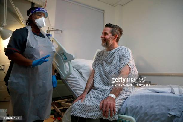Felicia Kwaku, Associate Director of Nursing speak with Justin Fleming as he recovers from Covid-19 on the Cotton ward at King's College Hospital at...