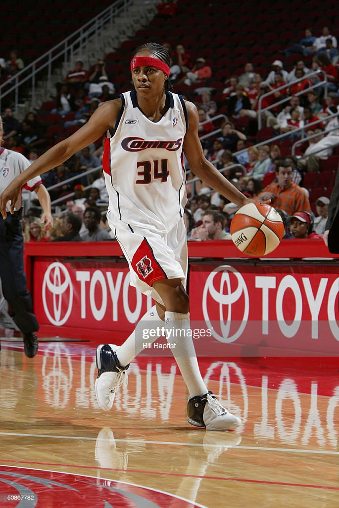 Felicia Ragland #34 of the Houston Comets looks to make a play on the dribble against the Connecticut Sun during the preseason game at Toyota Center on May 11, 2004 in Houston, Texas. The Comets won 84-71.