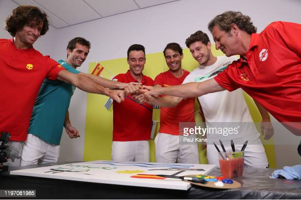Feliciano Lopez Albert RamosVinolas Roberto Bautista Agut Rafael Nadal Pablo Carreno Busta and Francisco Roig of Team Spain paint during a media...