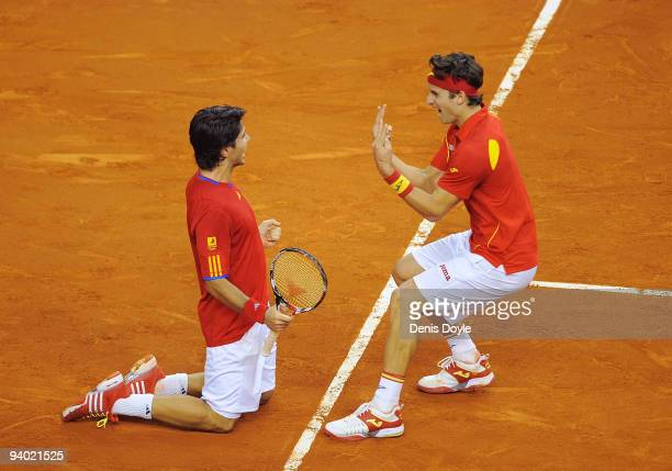 Feliciano Lopez and Fernando Verdasco of Spain celebrate after beating Radek Stepanek and Tomas Berdych of Czech Republic during Davis Cup World...