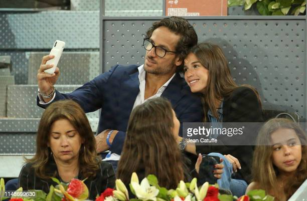 Feliciano Lopez and fiancee Sandra Gago attend the victory of Rafael Nadal of Spain during day 7 of the Mutua Madrid Open at La Caja Magica on May 10...