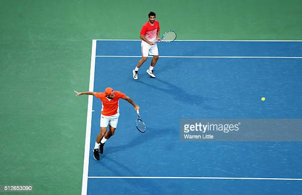 Feliciano Lopez and Marc Lopez of Spain in action against Simone Bolelli and Andreas Seppi of Italy in the men's doubles final of the ATP Dubai Duty...