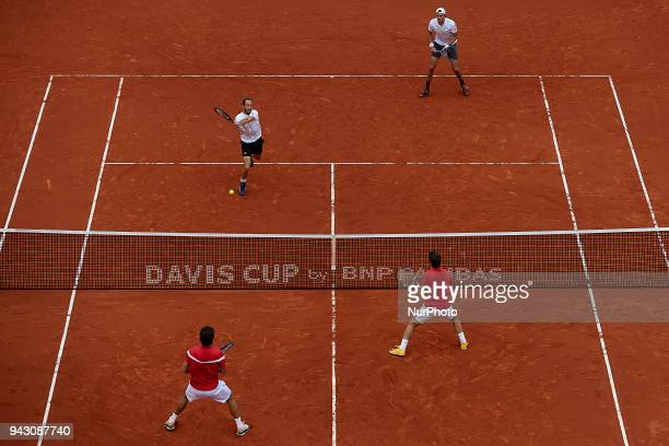 Feliciano Lopez and Marc Lopez of Spain in action in their doubles match against Tim Putz and JanLennard Struff of Germany during day two of the...