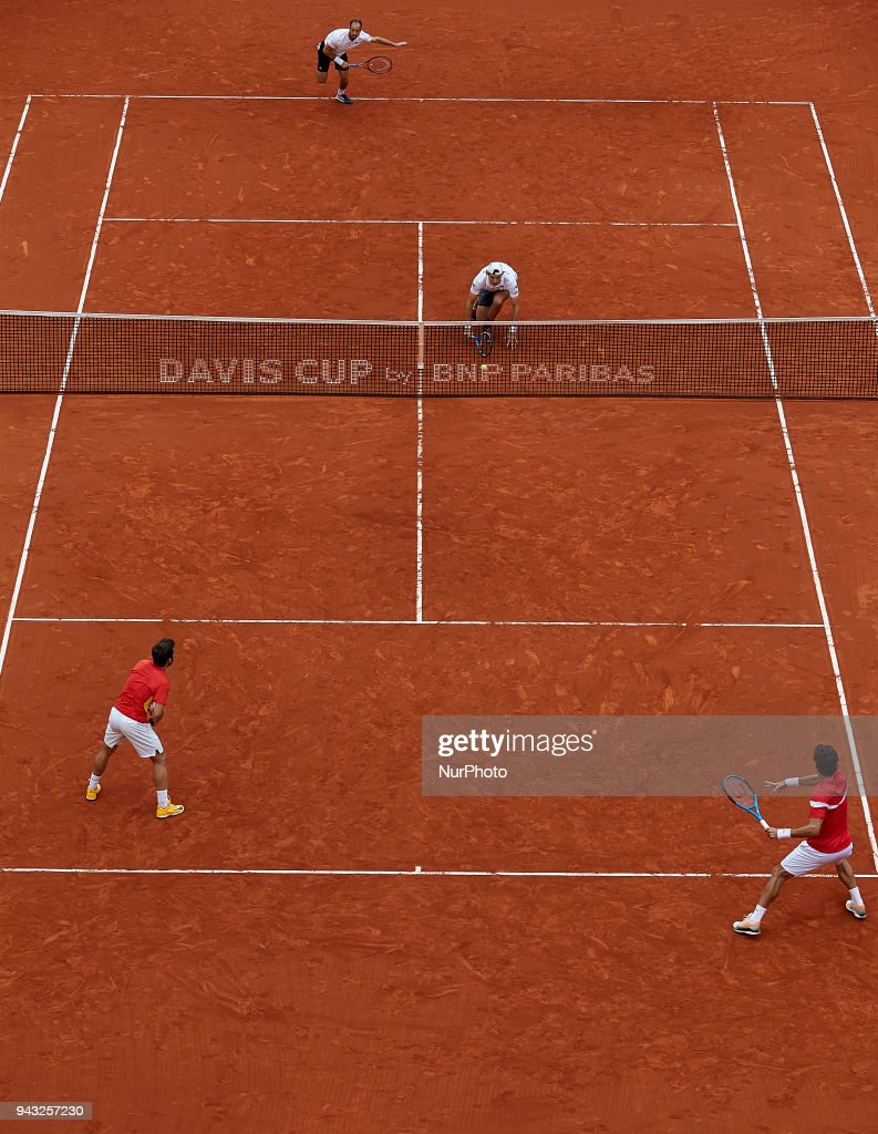 Feliciano Lopez (R in red) and Marc Lopez (L in red) of Spain in action in their doubles match against Tim Putz (L in white) and Jan-Lennard Struff of Germany during day two of the Davis Cup World Group Quarter Finals match between Spain and Germany at Plaza de Toros de Valencia on April 7, 2018 in Valencia, Spain