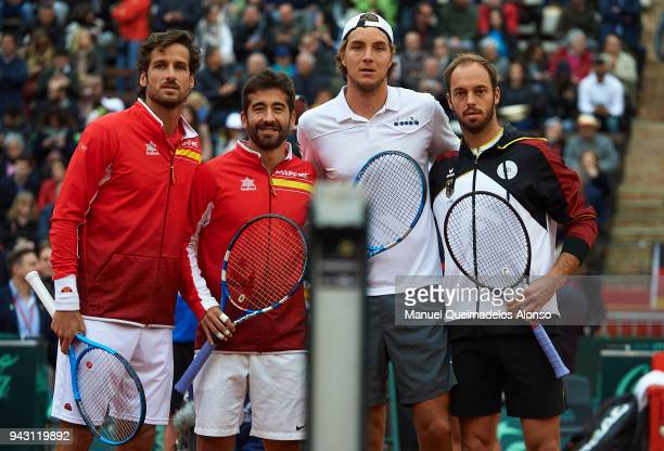 Feliciano Lopez and Marc Lopez of Spain stand at net together with Tim Puetz and JanLennard Struff of Germany before day two of the Davis Cup World...