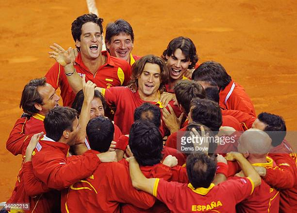Feliciano Lopez David Ferrer and Rafael Nadal of Spain celebrate with their team mates after Feliciano Lopez and Fernando Verdasco of Spain beat...