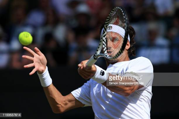 Feliciano Lopez in action against Karen Khachanov during their Gentlemen's Singles 2nd Round match on Day 3 of The Championships - Wimbledon 2019 at...