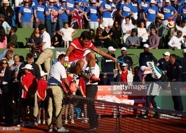 Feliciano Lopez jumps the net after his win with Pablo Carreno Busta of Spain over Dom Inglot and Jamie Murray of Great Britain in the doubles during...