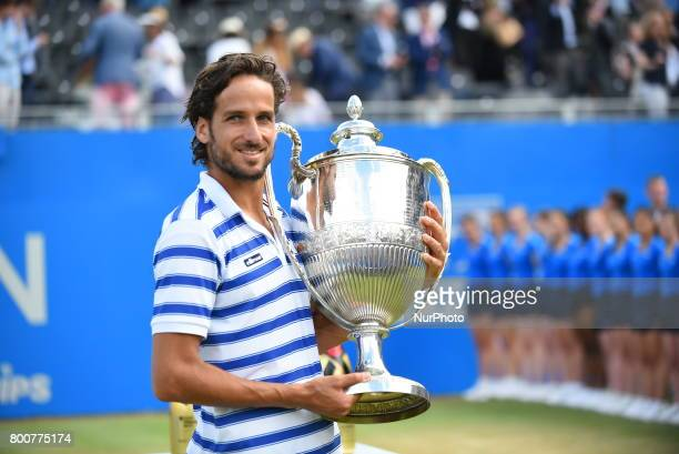 Feliciano Lopez of Spain celebrates and holds the trophy after defeating Marin Cilic of Croatia in final of AEGON Championships at Queen's Club...