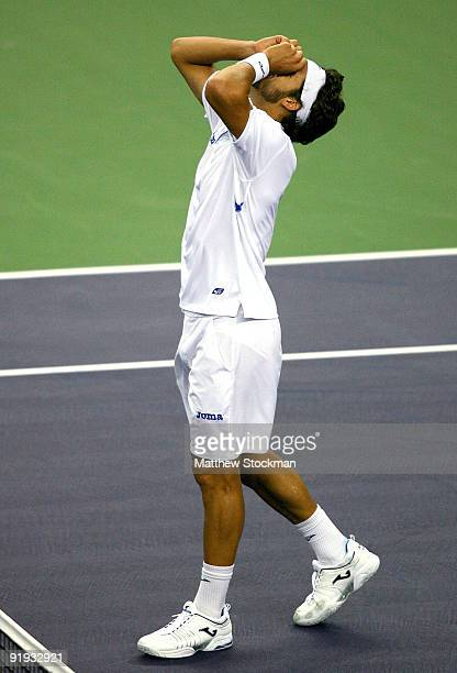 Feliciano Lopez of Spain celebrates match point against Robin Soderling of Sweden during day six of the 2009 Shanghai ATP Masters 1000 at Qi Zhong...