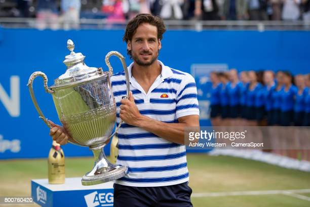 Feliciano Lopez of Spain celebrates with the Trophy after his victory against Marin Cilic of Croatia in their Men's Singles Final Match during Day 7...