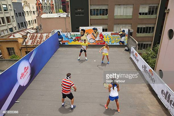Feliciano Lopez of Spain Elina Svitolina of Ukraine Pat Cash of Australia and Monica Puig of Puerto Rico play a game of tennis on the rooftop after...