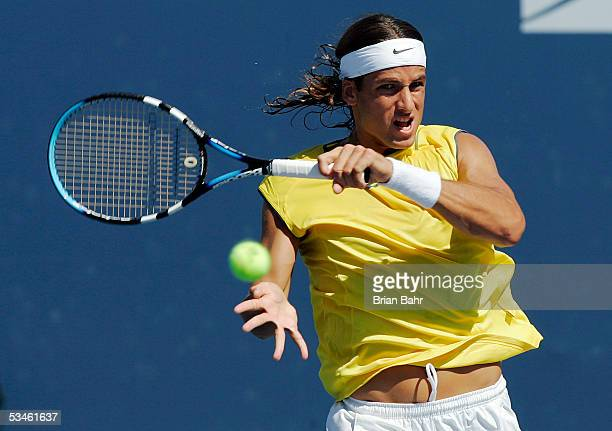 Feliciano Lopez of Spain follows through on a backhand against Vincent Spadea during the Pilot Pen Tennis tournament on August 25 2005 at the...