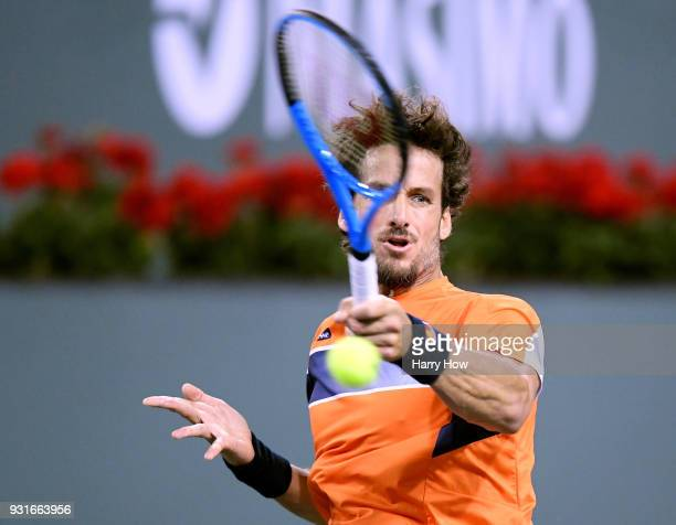 Feliciano Lopez of Spain hits a forehand in his match against Jack Sock of the United States during the BNP Paribas Open at the Indian Wells Tennis...