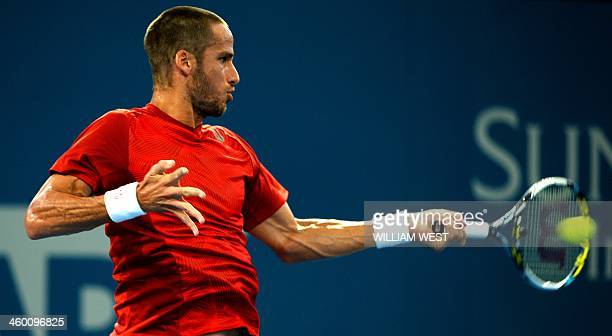 Feliciano Lopez of Spain hits a forehand return in his match against Lleyton Hewitt of Australia at the Brisbane International tennis tournament in...