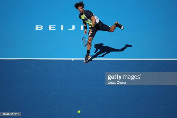 Feliciano Lopez of Spain hits a return against Borna Coric of Croatia during their Men's Singles 1nd Round match of the 2018 China Open at the China...