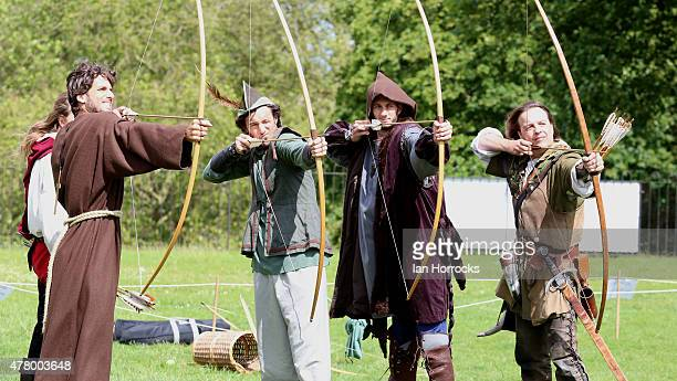 Feliciano Lopez of Spain Juan Monaco of Argentina and James Ward of GB get a lesson in archery from Robin Hood alias Tim Pollard whilst taking part...
