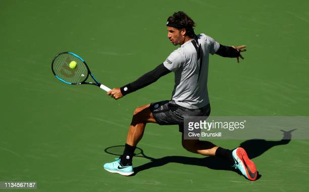 Feliciano Lopez of Spain plays a backhand against Tomas Berdych of the Czech Republic during their men's singles first round match on day five of the...