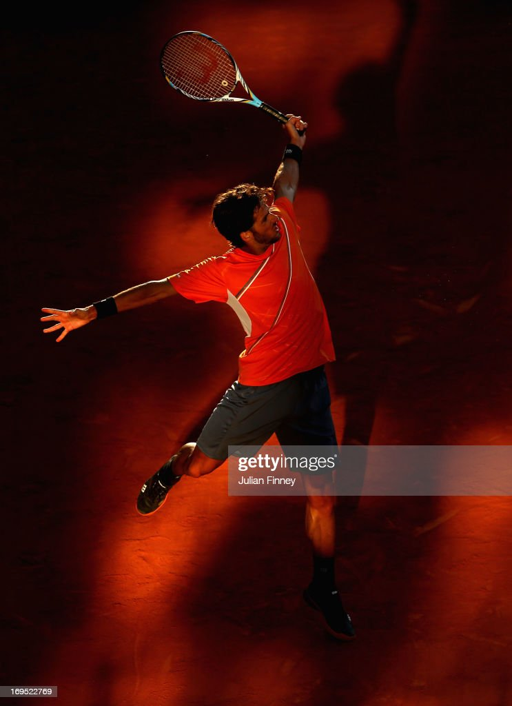 Feliciano Lopez of Spain plays a backhand during his men's singles match against Marcel Granollers of Spain on day one of the French Open at Roland Garros on May 26, 2013 in Paris, France.