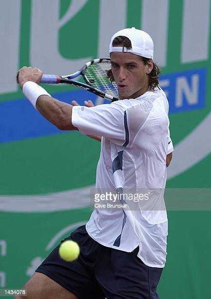 Feliciano Lopez of Spain plays a backhand on his way to a straight sets victory over Marat Safin of Russia during the second round of the Salem Open...