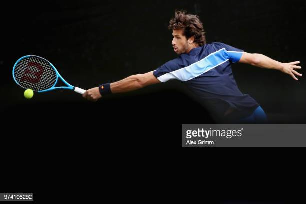 Feliciano Lopez of Spain plays a backhand to Gilles Simon of France during day 4 of the Mercedes Cup at Tennisclub Weissenhof on June 14, 2018 in...