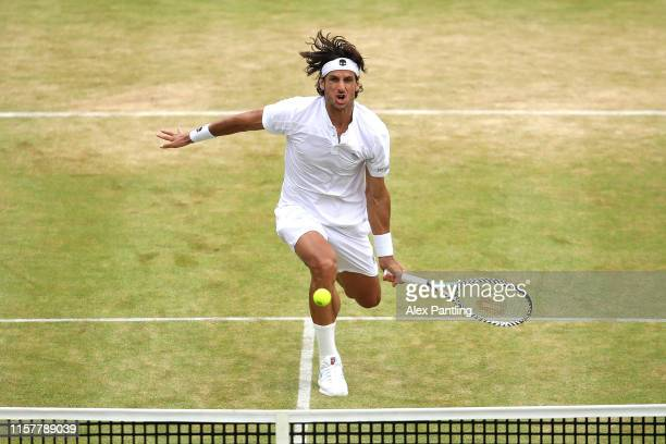 Feliciano Lopez of Spain plays a forehand during the mens singles final against Gilles Simon of France during day seven of the FeverTree...