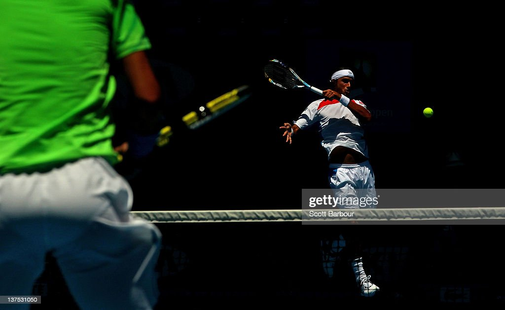 Feliciano Lopez of Spain plays a forehand in his fourth round match against Rafael Nadal of Spain during day seven of the 2012 Australian Open at Melbourne Park on January 22, 2012 in Melbourne, Australia.