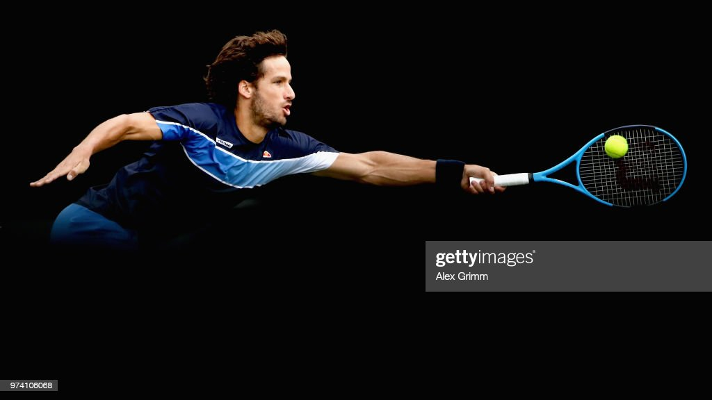 Feliciano Lopez of Spain plays a forehand to Gilles Simon of France during day 4 of the Mercedes Cup at Tennisclub Weissenhof on June 14, 2018 in Stuttgart, Germany.