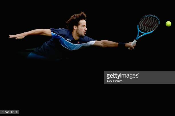 Feliciano Lopez of Spain plays a forehand to Gilles Simon of France during day 4 of the Mercedes Cup at Tennisclub Weissenhof on June 14, 2018 in...