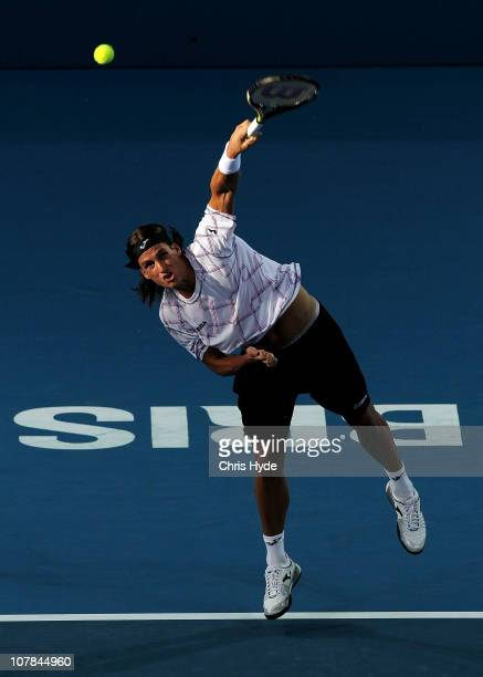 Feliciano Lopez of Spain plays serves during his first round match against Phillipp Petzschner of Germany during day one of the Brisbane...