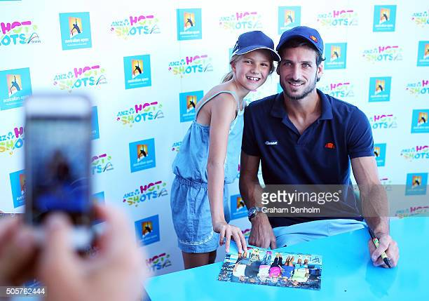 Feliciano Lopez of Spain poses with a young fan at Autograph Island during day three of the 2016 Australian Open at Melbourne Park on January 20 2016...