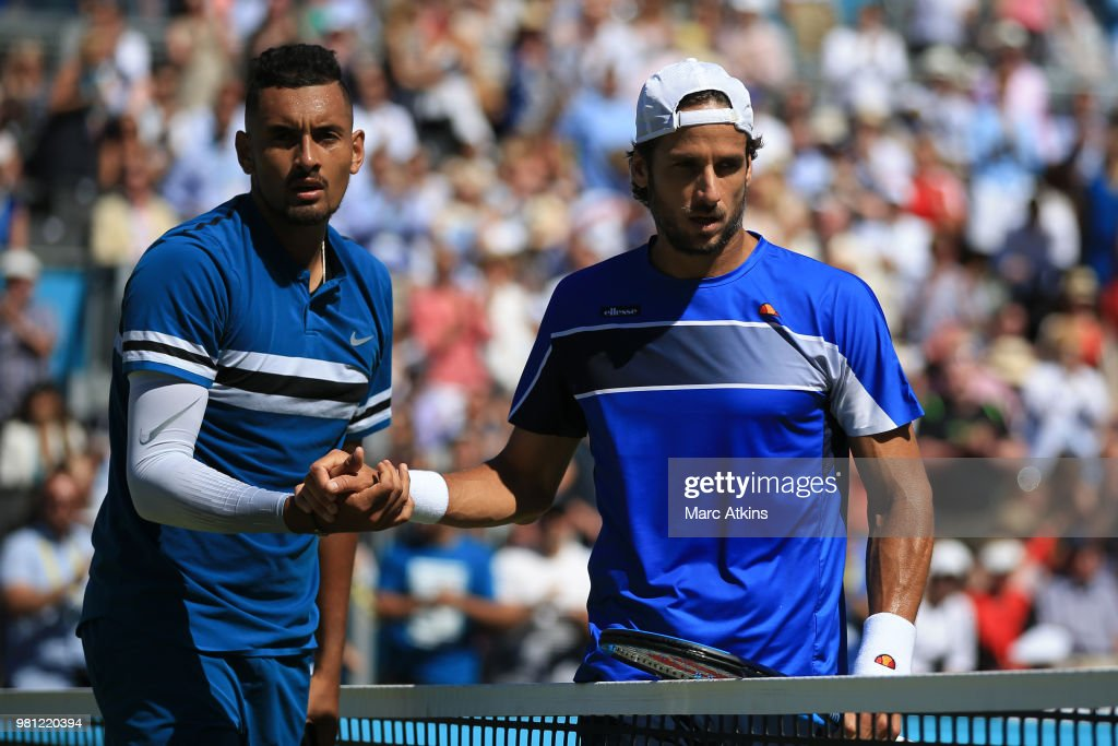 Feliciano Lopez of Spain (R) reacts after defeat to Nick Kyrgios of Australia (L) during their 1/4 final match on Day 5 of the Fever-Tree Championships at Queens Club on June 22, 2018 in London, United Kingdom.