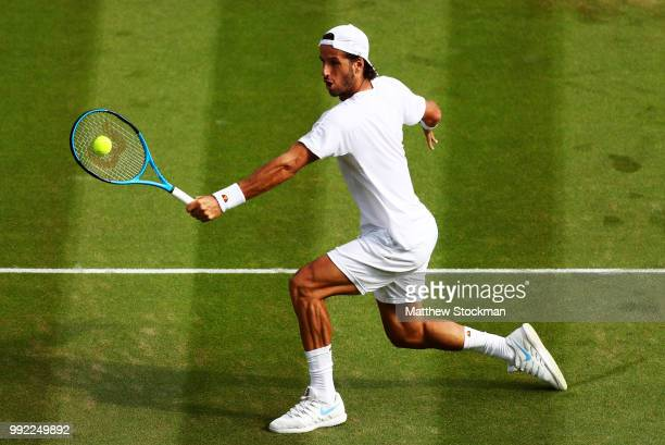 Feliciano Lopez of Spain returns a shot against Juan Martin del Potro of Argentina during their Men's Singles second round match on day four of the...