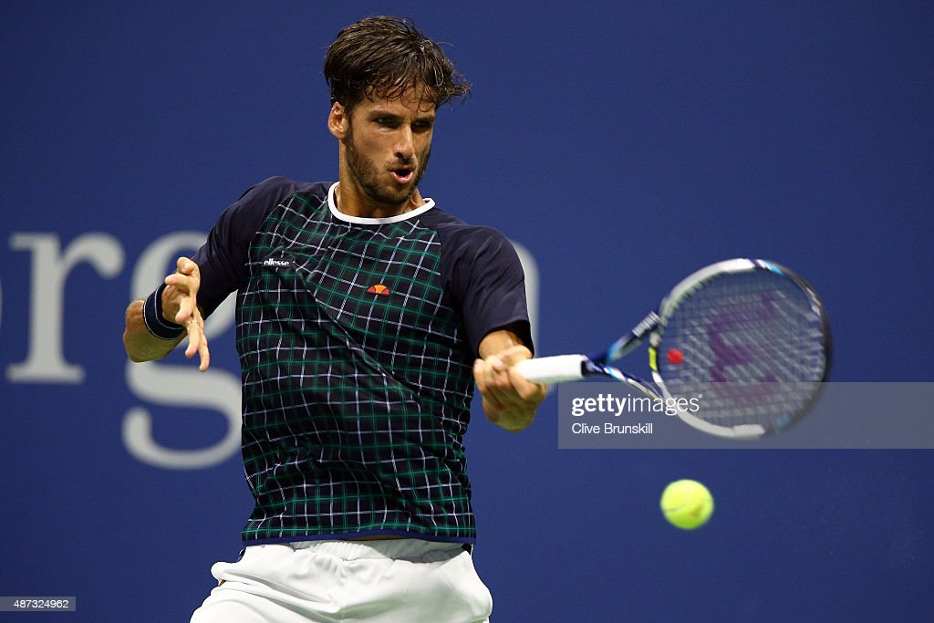 Feliciano Lopez of Spain returns a shot against Novak Djokovic of Serbia during their Men's Singles Quarterfinals match on Day Nine of the 2015 US Open at the USTA Billie Jean King National Tennis Center on September 8, 2015 in the Flushing neighborhood of the Queens borough of New York City.