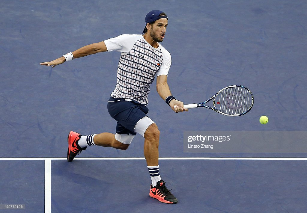 Feliciano Lopez of Spain returns a shot against Novak Djokovic of Serbia during the men's singles third round match on day 5 of Shanghai Rolex Masters at Qi Zhong Tennis Centre on October 15, 2015 in Shanghai, China.