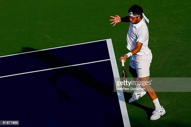Feliciano Lopez of Spain returns a shot to David Ferrer of Spain during the 2009 Shanghai ATP Masters 1000 at Qi Zhong Tennis Centre on October 14...