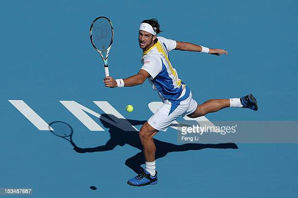 Feliciano Lopez of Spain returns a shot to JoWilfried Tsonga of France during the Men's Single Semifinal of China Open at the China National Tennis...